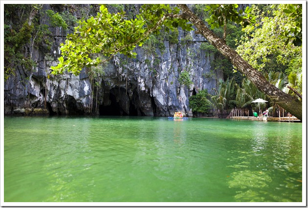 Boat coming out of the cave on the Underground River